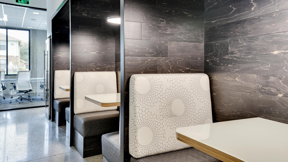 Red River's design team used engineered hardwood wall cladding to offset the black, white and gray palette in this meeting space.